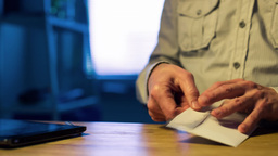 Man opens and sign a letter to the document Footage