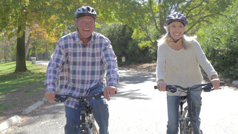 Senior Couple On Cycle Ride In Countryside stock footage