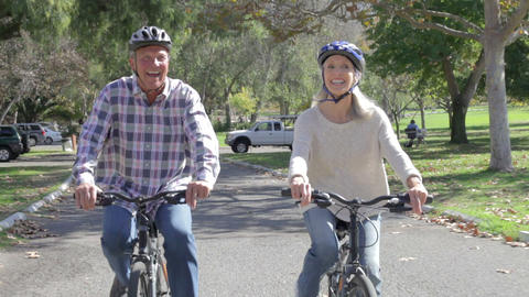 Senior Couple On Cycle Ride In Countryside Footage