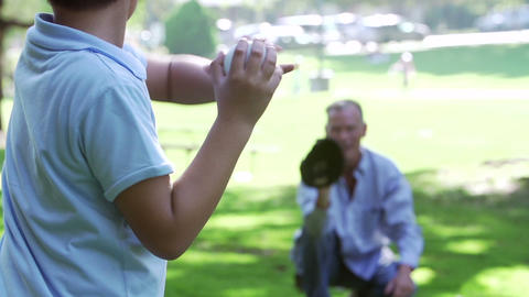 Slow Motion Shot As Grandfather Plays Baseball Wit Footage