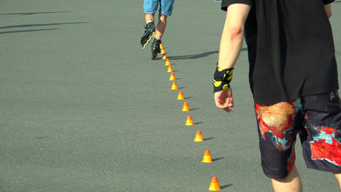 Skating on roller skates between cones. The snake. Footage
