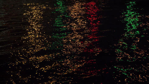 Reflections of coloured lights in the night the ri Footage