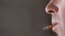 Flipping Cigarette Into Mouth stock footage