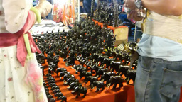 Stall selling hand-carved wooden elephants at nigh Footage
