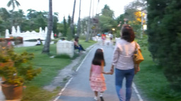 Woman And Child Strolling At Suan Buak Haad Park stock footage