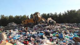 Garbage dump. Bulldozer working at garbage landfil Live Action