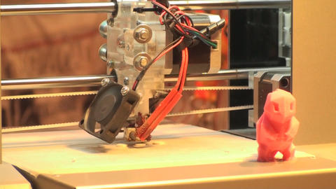 3D Printer Working On Printing A Plastic Figurine, Footage