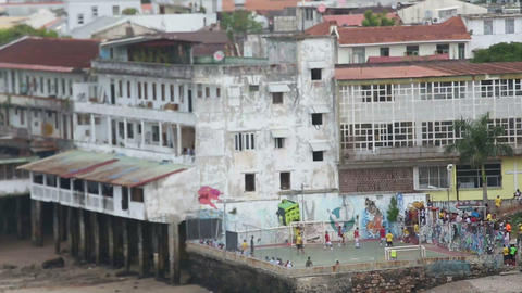 People playing football outside of shanty houses Footage
