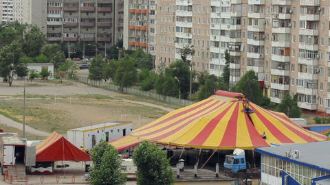 Worker undo lacing line on circus pavilion Live Action