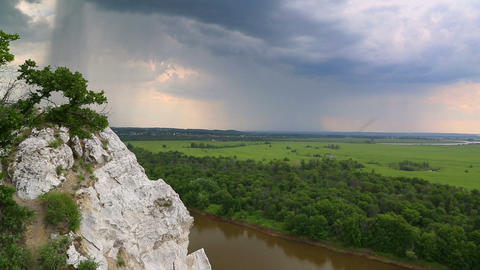 landscape with river and rain on horizon - view fr Footage