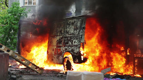 Burning Car In The Center Of City During Unrest In stock footage