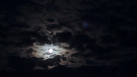 Full moon in clouds at night timelapse Footage