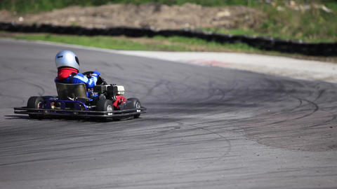 Go-kart in a curve rear view Live Action