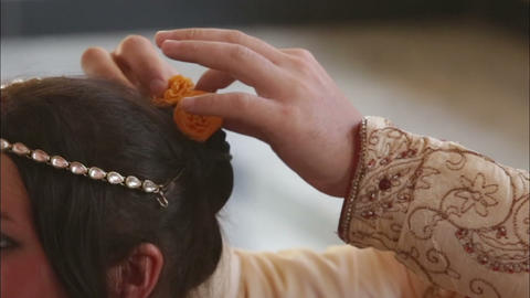 groom put hair flower Footage