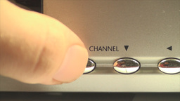 HDTV Box Hand Detail Pushing The Volume Button, Te Footage
