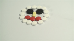 Pills Forming A Face On A White Background, Medica stock footage