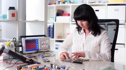 woman installs Computer Footage