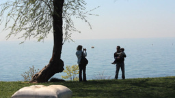 Dad, Mom And Son Taking Photograph At Coast stock footage