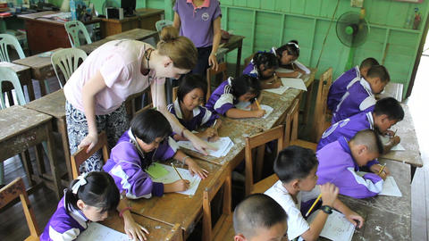 Missionary Teaching English To Asian Children Footage