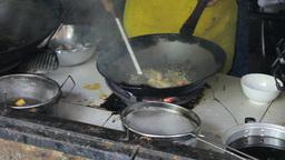 Frying Egg In Wok Making Thai Food Footage