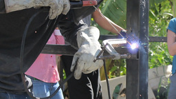 Missions Team Welding Metal On Housing Project Footage
