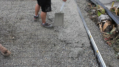 Missions Team Shovelling Wet Cement ビデオ