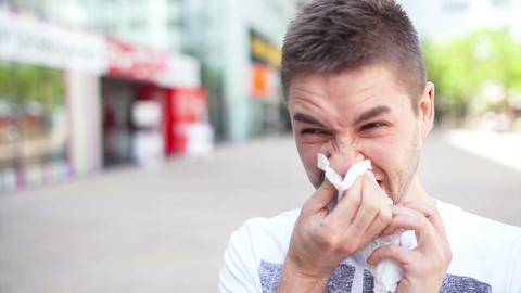 Video portrait of a confident man blowing his nose Footage