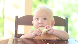baby try eat bread Footage