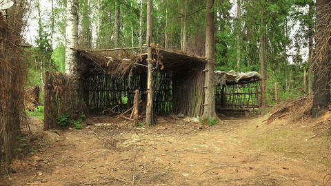 Military earth-houses and huts in the forest. 4K Footage