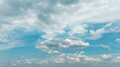 Fluffy White Clouds on Blue Sky, timelapse 4K Footage