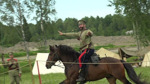 Soldier on a horse with a sword in his mouth. The  Footage