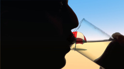 Man Greedily Drinks Water On A Beach Background stock footage