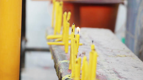 row of candles in buddhistic temple outdoor Live Action