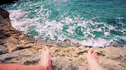 feet on a rock and sea Stock Video Footage