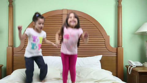 Girls jumping in the bed Footage