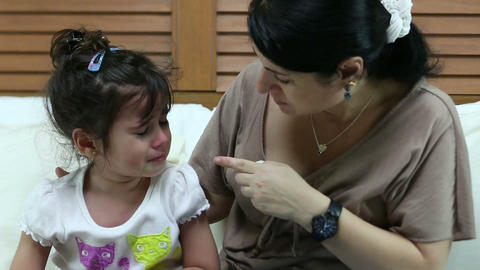 Girl crying in the bedroom. Her mother teaching to Footage