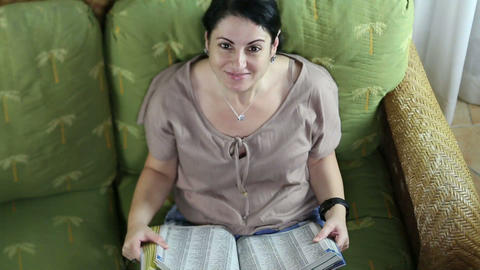 Top view of a happy woman reading a book Footage