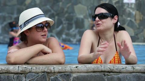 Female Friends In Swimming Pool Footage