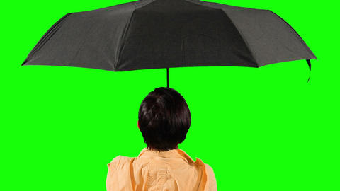Close-up of a woman opens an umbrella. Green scree Live Action