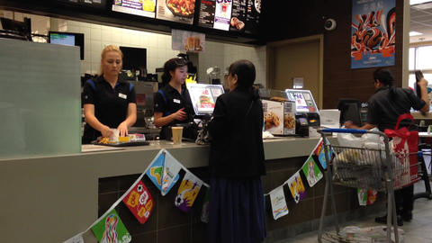 Woman Ordering Food At McDonalds stock footage
