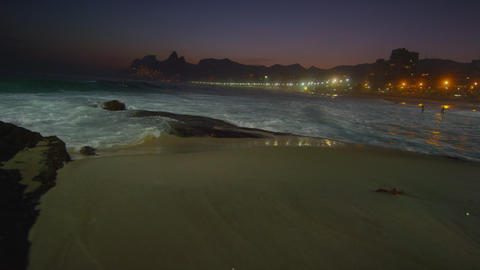 Slow motion, pan left of the waves flowing in at Ipanema beach Footage