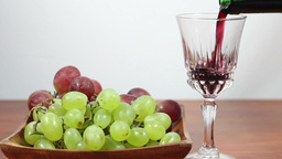 Red Wine Pouring Into A Glass. Grapes. 4 Footage