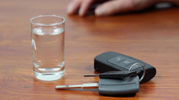 Drunk driving. Vodka and car keys Footage