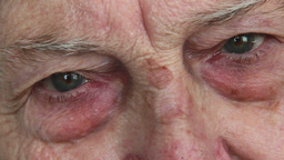 Closeup on the eyes and wrinkles of elderly woman Footage