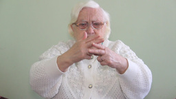 Old, deaf woman is using sign language Footage