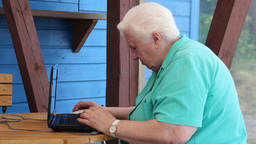 Old woman have problem with her laptop Stock Video Footage
