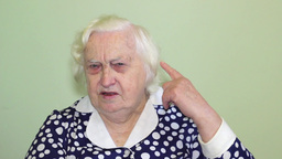 Old woman has a hearing problem Stock Video Footage