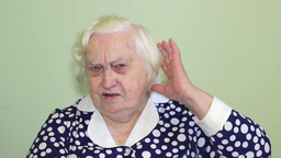 Old Woman Has A Hearing Problem stock footage
