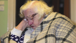 Elderly woman fell asleep at the table Footage
