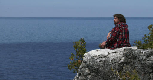 Hiker resting and contemplating the panorama Footage